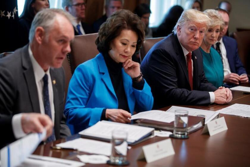 US President Donald J. Trump (R), with Secretary of Transportation Elaine Chao (C), listens as Secretary of Interior Ryan Zinke (L) delivers a report during a Cabinet meeting in the Cabinet Room of the White House in Washington, DC, USA.EFE/EPA/FILE