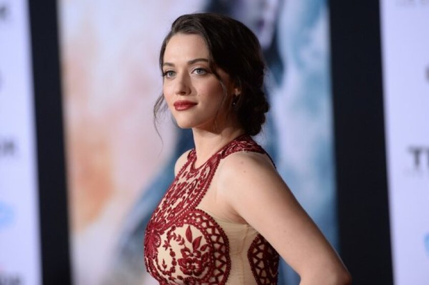 """Kat Dennings arrives at the premiere of """"Thor: The Dark World"""" at the El Capitan Theatre."""