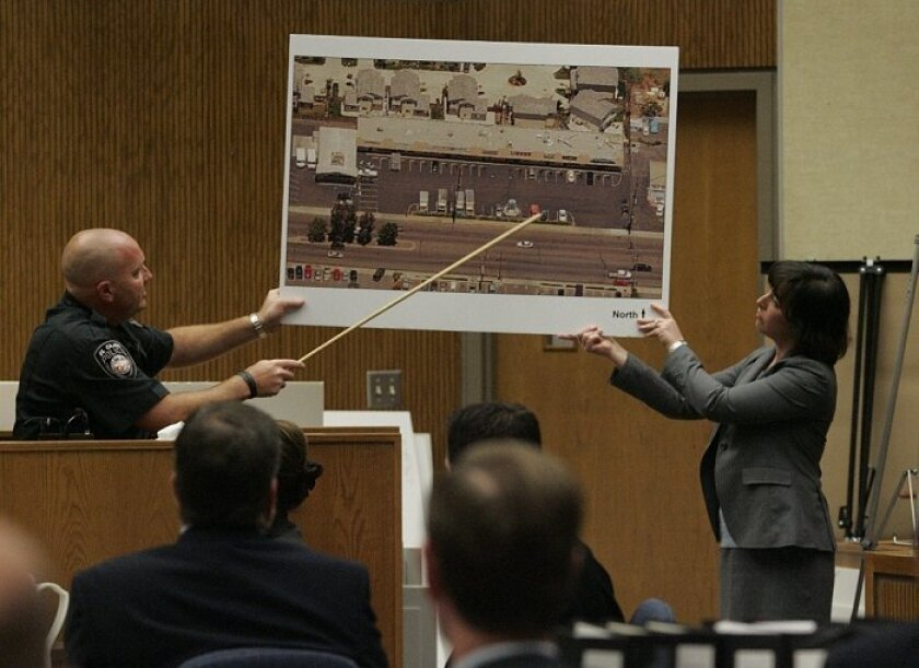 El Cajon police Officer Jason Taub explained the layout of the homicide scene as Deputy District  Attorney Jennifer Kaplan held the photo. Two men are accused of killing two people in an El  Cajon liquor store in 2006.