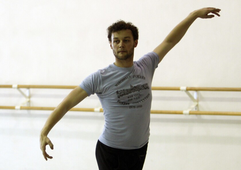 """FILE - In this Tuesday, Aug. 14, 2012 file photo, Royal Ballet choreographer Liam Scarlett works with Miami City Ballet dancers in Miami Beach, Fla. Choreographer Liam Scarlett, a dance star whose career was clouded by abuse allegations, has died aged 35. Scarlett's family said Saturday, April 17, 2021 that """"it is with great sadness that we announce the tragic, untimely death of our beloved Liam."""" (AP Photo/Lynne Sladky, file)"""