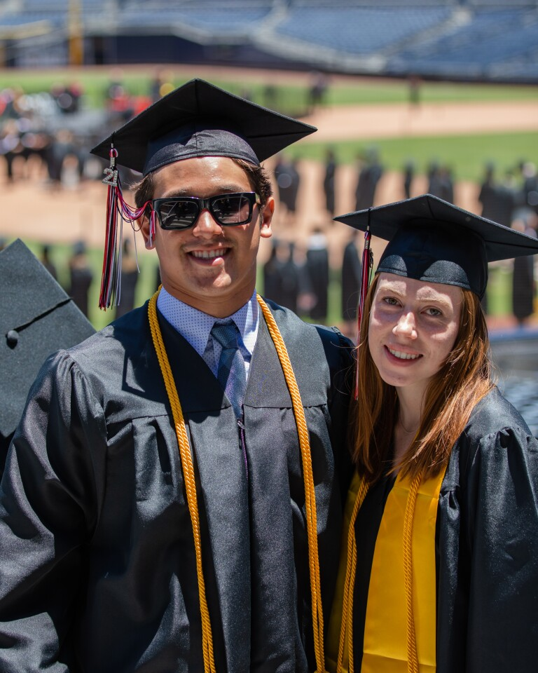 Max Smith and Taryn Snyder get set to head to the field to get their diplomas at La Jolla High School's graduation ceremony.