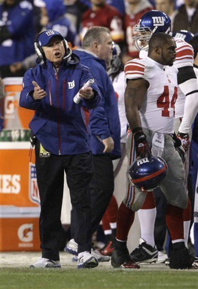 New York Giants head coach Tom Coughlin reacts to a play during the first half of an NFL football game against the Washington Redskins in Landover, Md. on Sunday, Jan. 2, 2011. (AP Photo/Jacquelyn Martin)