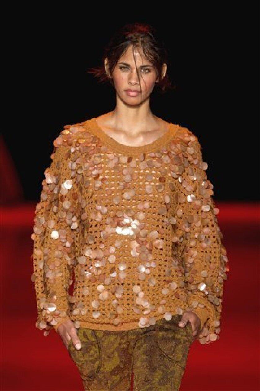 A model wears a creation from the Coven fall-winter fashion collection at Fashion Rio in Rio de Janeiro, Brazil, Wednesday Jan. 11, 2012. (AP Photo/Felipe Dana)