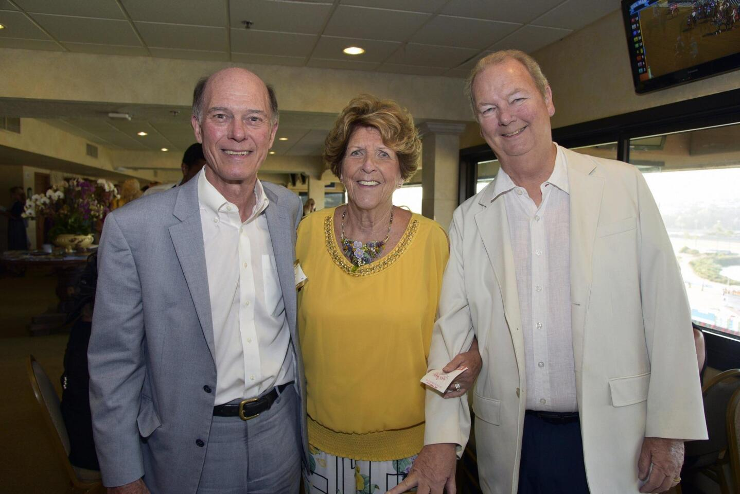 George Howard, Kathy and board member John Collins