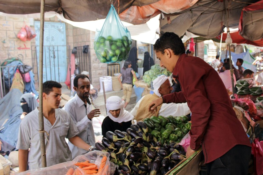 Residents of the city of Taizz in southwestern Yemen take advantage of a five-day humanitarian cease-fire to buy vegetables at a market on May 13.