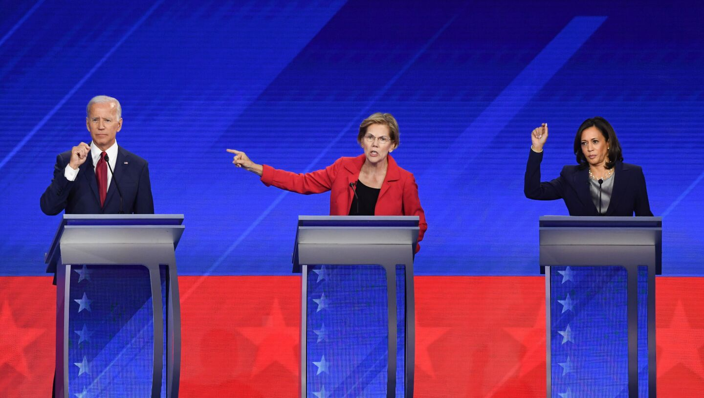 Democratic presidential hopefuls Former Vice President Joe Biden (L), Massachusetts Senator Elizabeth Warren (C) and California Senator Kamala Harris (R) speak during the third Democratic primary debate of the 2020 presidential campaign season hosted by ABC News in partnership with Univision at Texas Southern University in Houston, Texas on September 12, 2019. (Photo by Robyn BECK / AFP) (Photo credit should read ROBYN BECK/AFP/Getty Images)