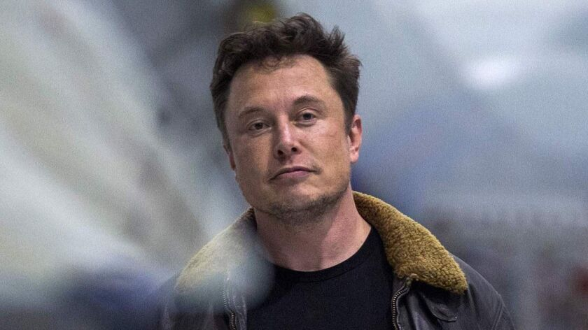 Elon Musk, shown in September, owns 22% of Tesla and has presided over its board of directors since he became chairman in 2003.