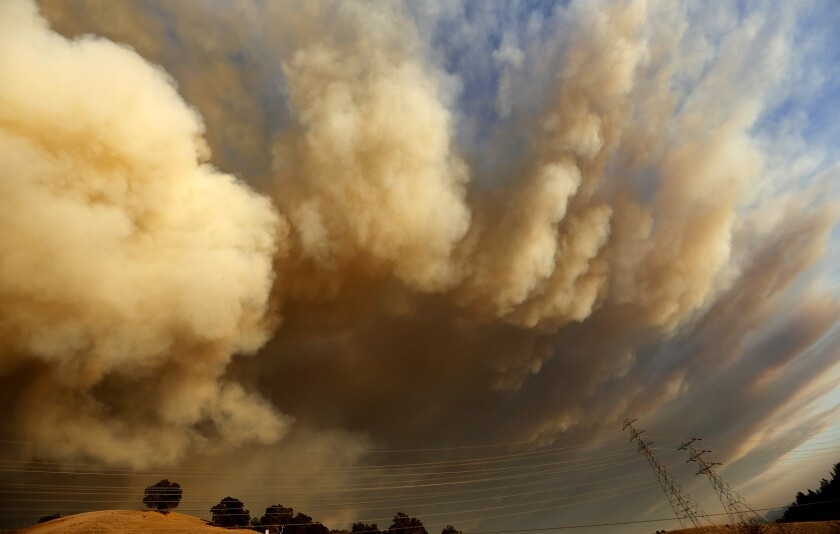 A huge plume of smoke rises from the Kincade fire