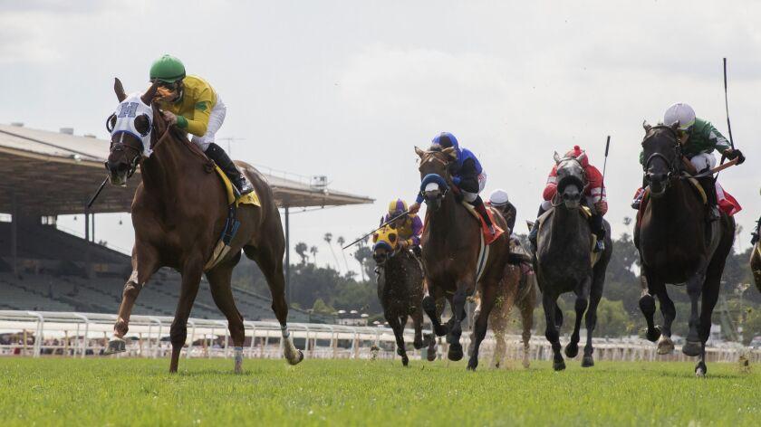 Horses and jockeys compete at Santa Anita Park in Arcadia, Calif. on May 27.
