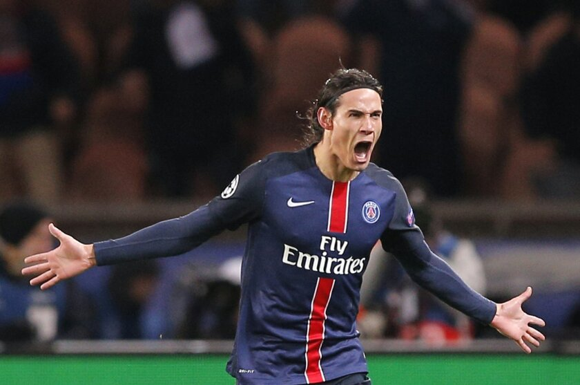 PSG's Edinson Cavani celebrates his goal during the Champions League round of 16, 1st leg soccer match between Paris Saint Germain and Chelsea at the Parc des Princes stadium in Paris, France, Tuesday, Feb. 16, 2016. (AP Photo/Christophe Ena)