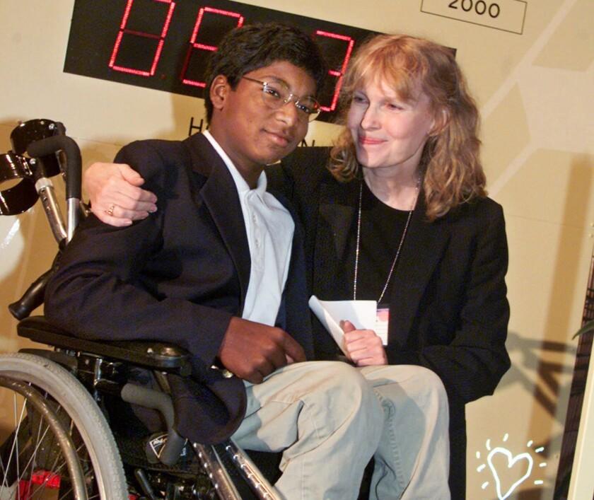 Mia Farrow with son Thaddeus