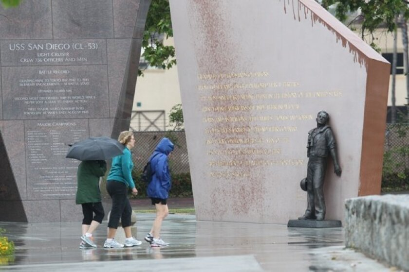 Visitors don't mind the rain during their trip to the USS San Diego memorial on May 6, 2013.