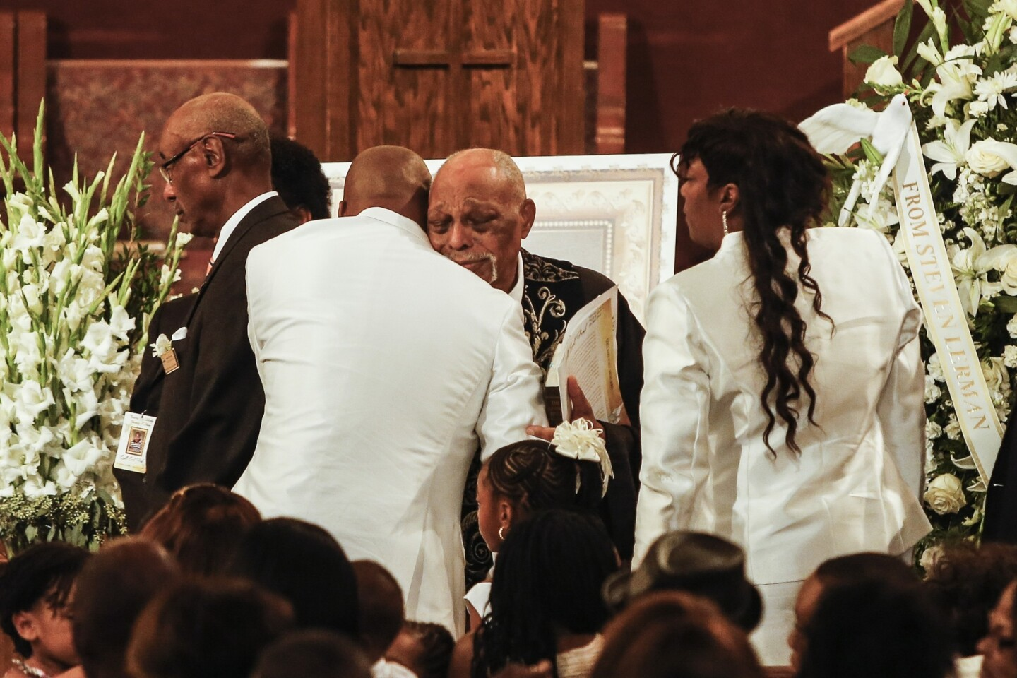 """The Rev. Cecil """"Chip"""" Murray, pastor emeritus at First African Methodist Episcopal Church, center, greets Edsell, left, and Tritobia Ford at the conclusion of the service."""