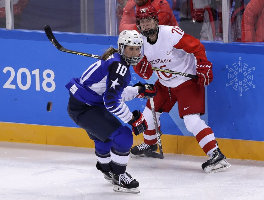 FILE - Meghan Duggan (10), of the United States, and Russian athlete Yekaterina Nikolayeva (76) chase the puck during the first period of the preliminary round of the women's hockey game at the 2018 Winter Olympics in Gangneung, South Korea, in this Tuesday, Feb. 13, 2018, file photo. Former U.S. national team captain Meghan Duggan was named manager of player development for the New Jersey Devils on Wednesday, May 19, 2021, the latest prominent women's hockey player to join an NHL team's front office. (AP Photo/Frank Franklin II, File)