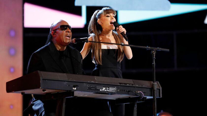 """Stevie Wonder and Ariana Grande perform """"Faith"""" on """"The Voice."""""""