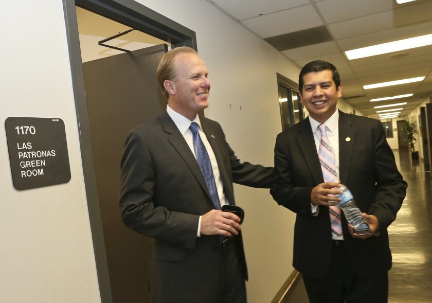 Mayor Kevin Faulconer, left, and City Councilman David Alvarez during their face off in the 2014 race for San Diego Mayor. (AP Photo/Lenny Ignelzi)