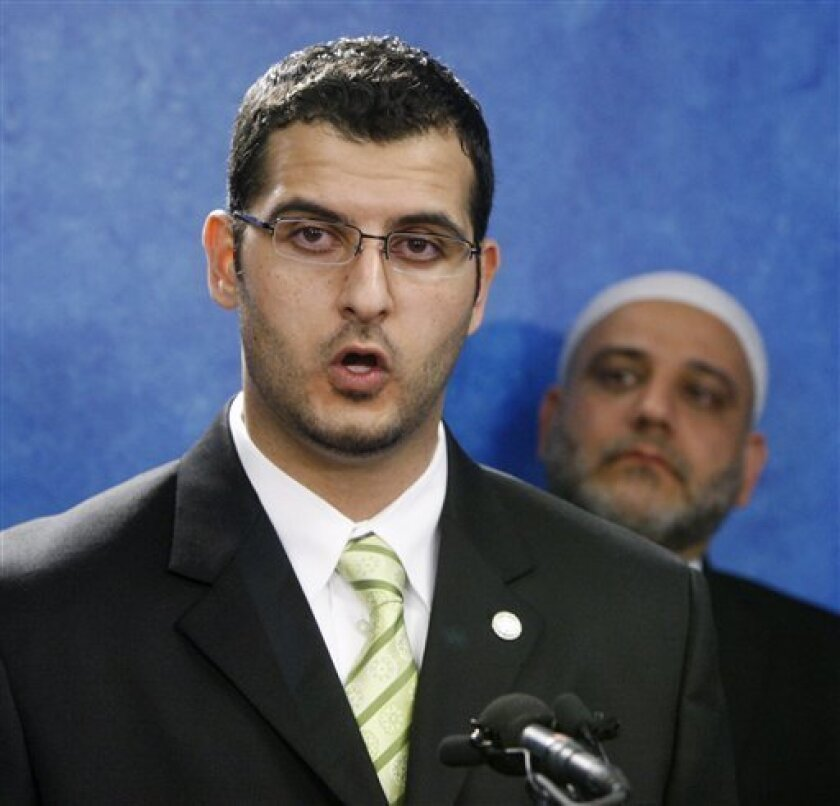 Muneer Awad, executive director of the Council on American-Islamic Relations - Oklahoma Chapter, left, answers questions during a news conference in Oklahoma City, Thursday, Nov. 4, 2010. The group says a legal challenge is planned against a ballot measure prohibiting state courts from considering international law or Islamic law when deciding cases. The ballot measure, State Question 755, was approved with 70 percent of the vote in Tuesday's general election. Awad says the measure is deceptive and makes it appear that there is a threat of some kind of Islamic takeover of state courts that does not exist. At right is Imad Enchassi, Imam - Islamic Society of Greater Oklahoma City. (AP Photo/Sue Ogrocki)