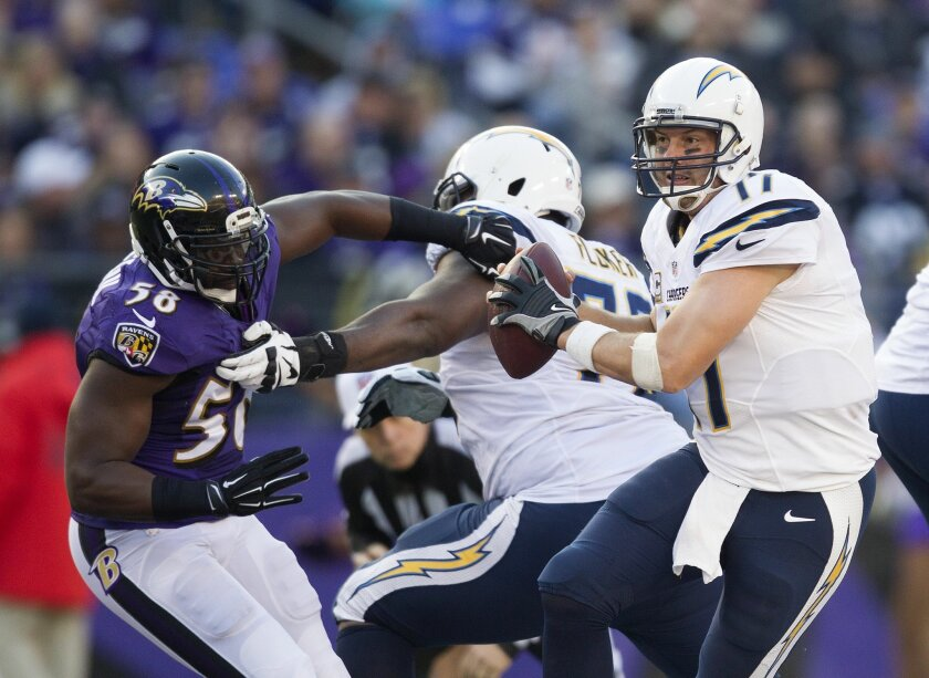 San Diego Chargers vs. Baltimore Ravens at M&T Bank Stadium. Baltimore Ravens outside linebacker Elvis Dumervil (58) flushes San Diego Chargers quarterback Philip Rivers (17) from the pocket in the fourth quarter.