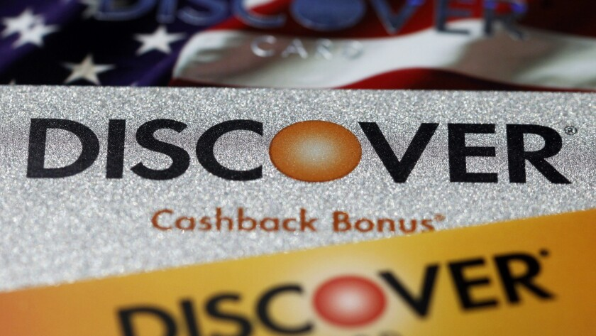 Discover Financial is shutting down a mortgage lending unit and laying off 460 employees in Irvine and Louisville, Ky. Above, the company's signature rewards cards.