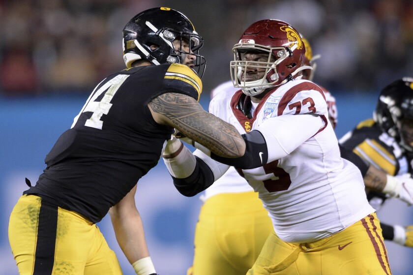 Iowa defensive end A.J. Epenesa, left, goes against USC offensive tackle Austin Jackson during the first half of the Holiday Bowl on Dec. 27, 2019, in San Diego.