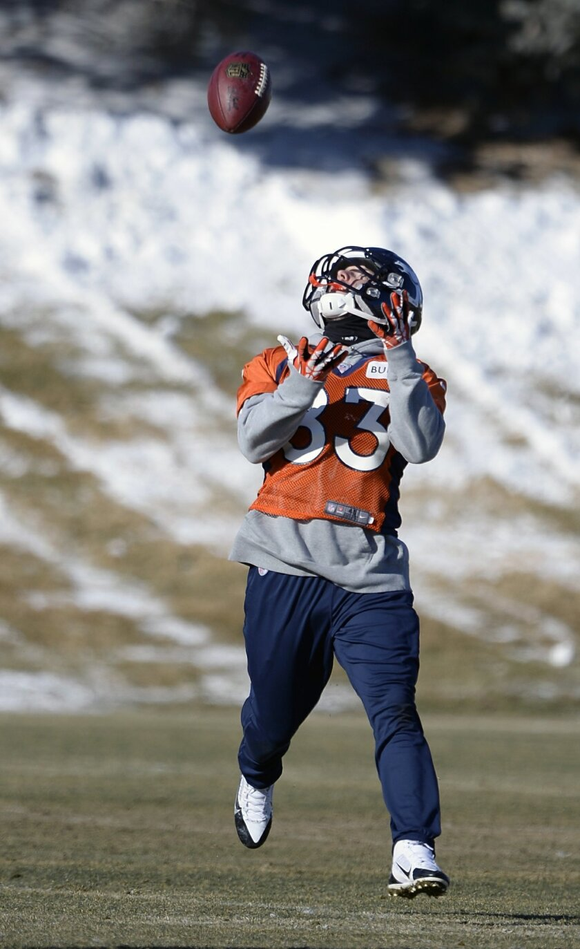 Denver Broncos wide receiver Wes Welker (83) catches a pass during practice at Dove Valley as they prepare for an NFL football game against the San Diego Chargers in the Divisional Round of the Playoffs on Jan. 6, 2014, in Englewood, Colo. (AP Photo/The Denver Post, John Leyba) MAGS OUT; TV OUT; INTERNET OUT; NO SALES; NEW YORK POST OUT; NEW YORK DAILY NEWS OUT