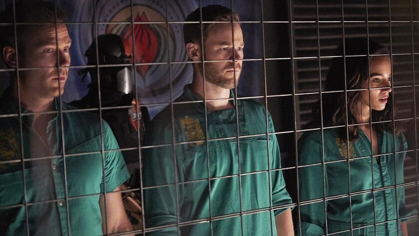 "Luke Macfarlane, left, Aaron Ashmore and Hannah John-Kamen in ""Killjoys"" on Syfy."