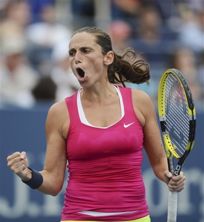 Italy's Roberta Vinci reacts during her match against Agnieszka Radwanska, of Poland, in the fourth round of play at the 2012 US Open tennis tournament,  Monday, Sept. 3, 2012, in New York. (AP Photo/Henny Ray Abrams)