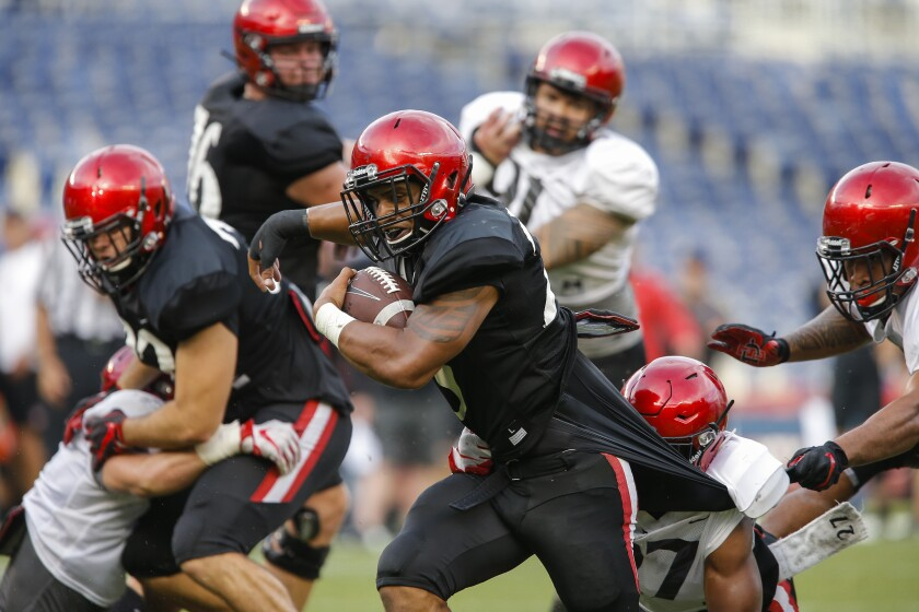 SDSU running back Kaegun Williams (26) gains an extra yard at the goal line ahead of scoring for the offense.