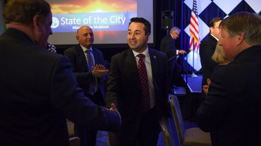 Newport Beach Councilman Kevin Muldoon, pictured when he was mayor in 2017, and council colleague Scott Peotter want the city to discuss joining or supporting the Trump administration's lawsuit against California over its immigration laws.
