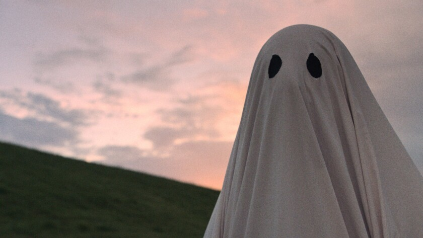 """That's Casey Affleck under the sheet in """"A Ghost Story,"""" a wrenching, elliptical story of longing and loss."""