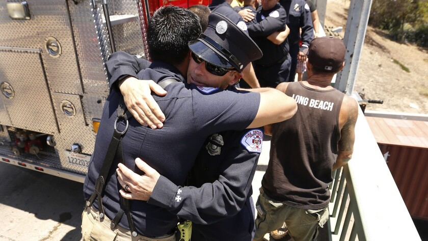 LONG BEACH, CA – JUNE 25, 2018: Long Beach Firefighters hug fellow firefighters gathered at West W