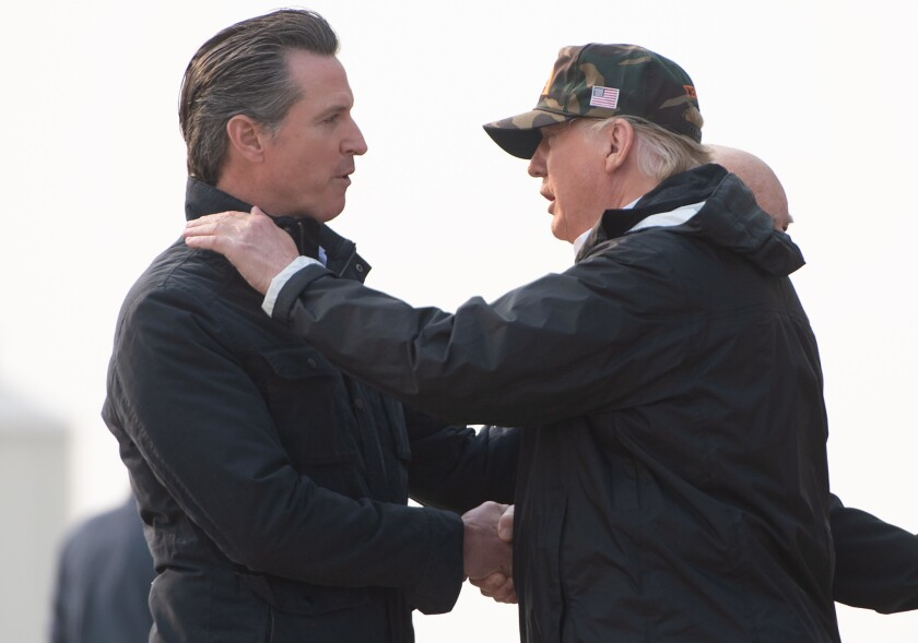 Gov.-elect Gavin Newsom greets President Trump at Beale Air Force Base north of Sacramento on Nov. 17, 2018.