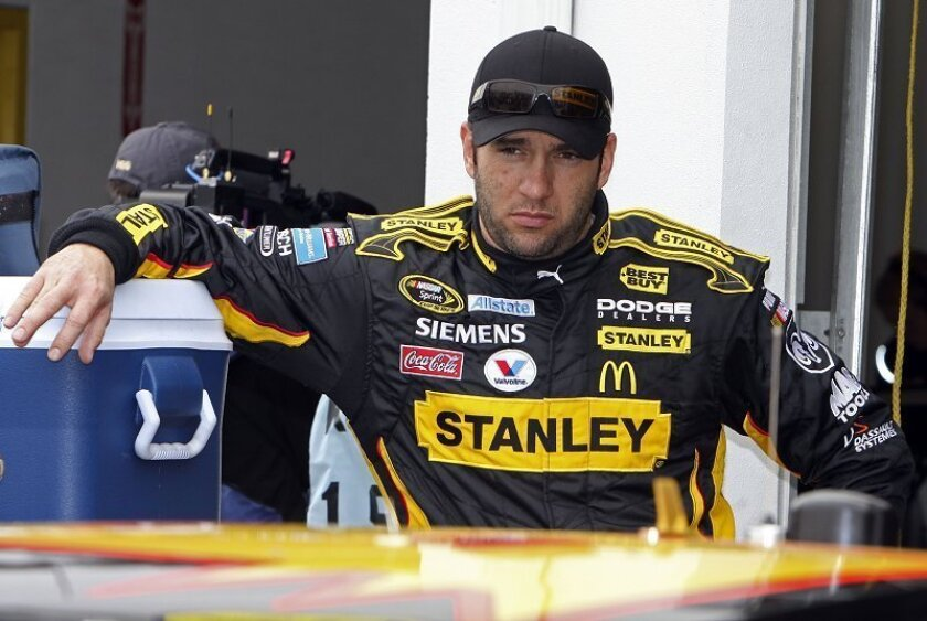 Driving for Petty Enterprises, Elliott Sadler is seen during practice for the Daytona 500 NASCAR auto race at Daytona International Speedway on Feb. 14. Sadler finished fifth in the Daytona 500, his best showing in over six months with a payday of more than $515,000.  (AP Photo/Darryl Graham, File)