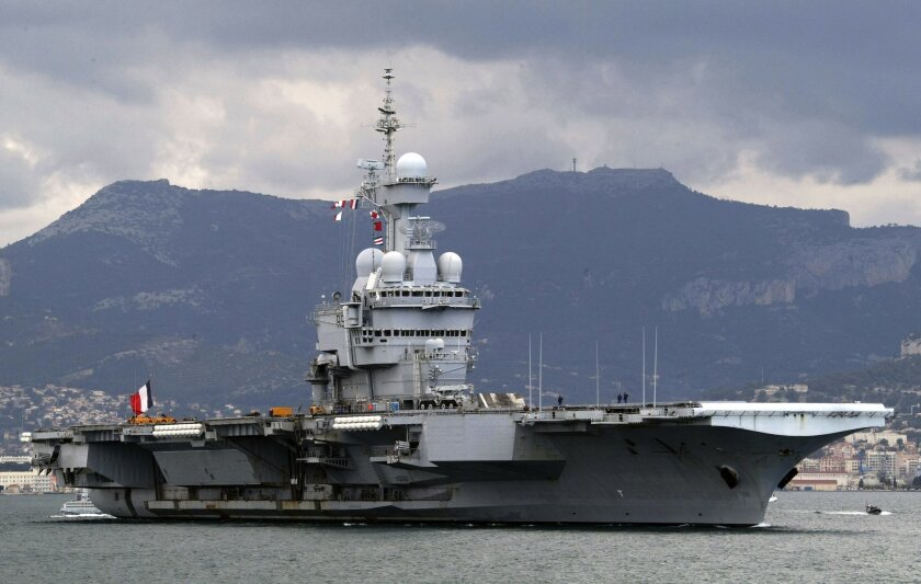 FILE - In this March 20, 2011 file photo, France's nuclear-powered aircraft carrier Charles de Gaulle leaves its home port of Toulon, southern France. France has decided to deploy an aircraft carrier in the Persian Gulf to help fighting Islamic State group in Iraq and Syria. The French president Fr