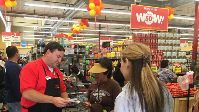 Imperial Beach Grocery Outlet owner Marc Aronsohn talks with customer Linda Nygaard during the July