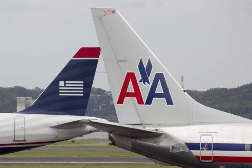A labor dispute at US Airways threatens to disrupt the planned merger with American Airlines.
