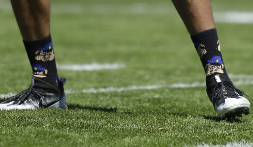 Colin Kaepernick wore some interesting socks during training camp on Aug. 10.