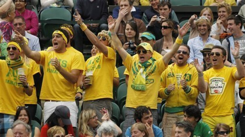 Fans of Australia's Lleyton Hewitt watch his match against Sweden's Robin Soderling at the All England Lawn Tennis Championships at Wimbledon, Thursday, June 23, 2011. (AP Photo/Anja Niedringhaus)