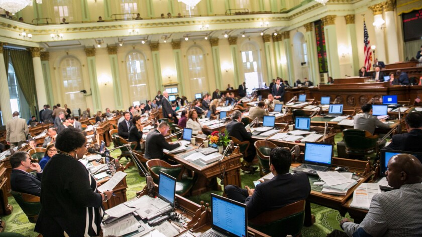 Assemblywoman Shirley Weber (D-San Diego), bottom left, speaks on the State Assembly floor in Sacramento.