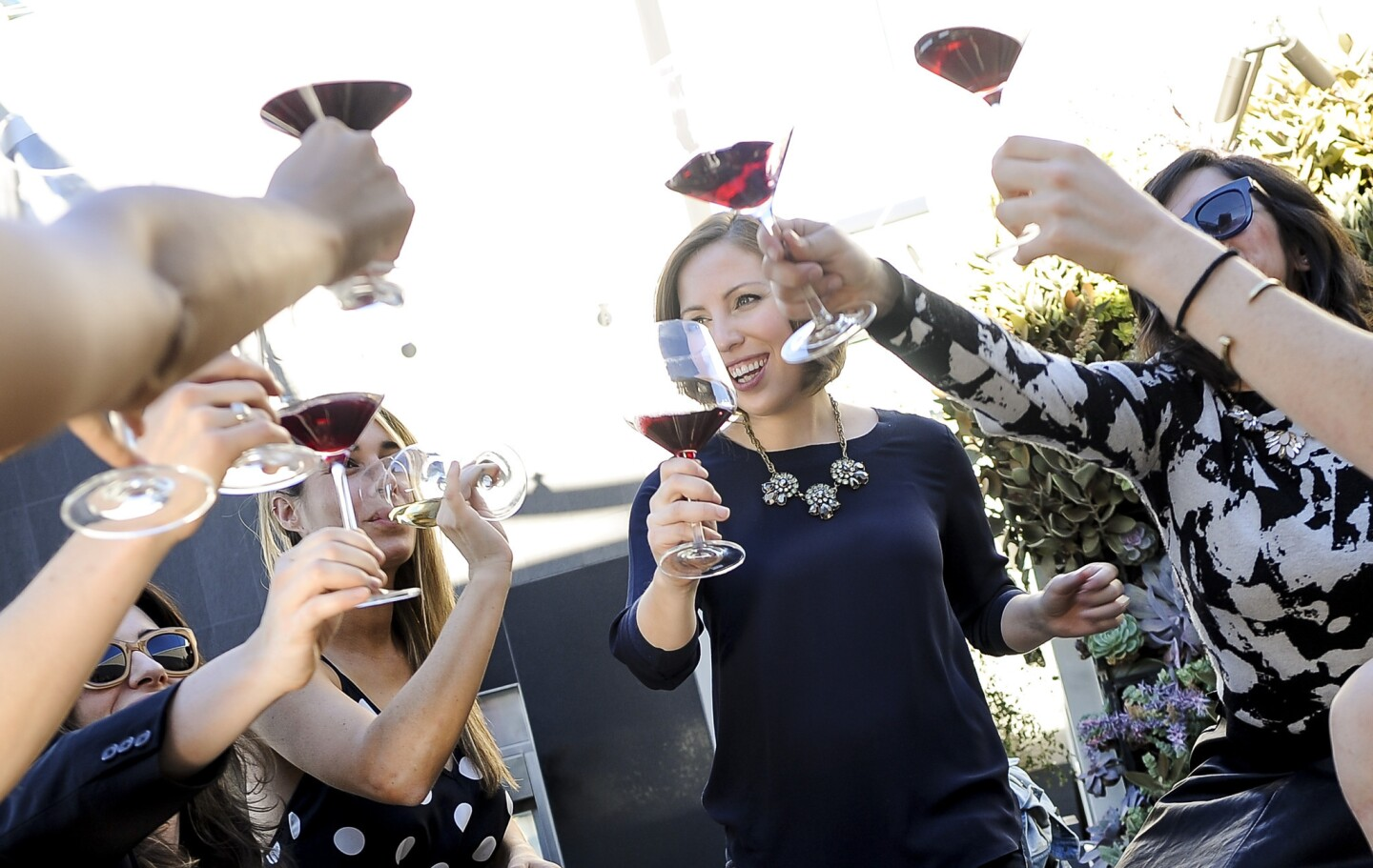 Elizabeth Huettinger, wine director at Otium restaurant, center, hosts a gathering of sommeliers and friends at her apartment building, the newly completed Emerson in downtown L.A.