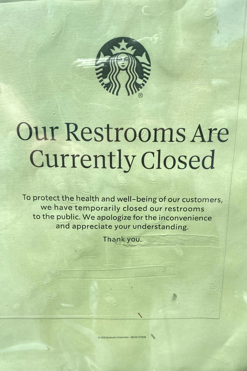 A sign saying restrooms are closed at a Starbucks on Melrose Avenue.