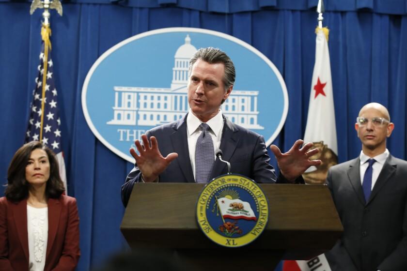 California Gov. Gavin Newsom speaks to reporters