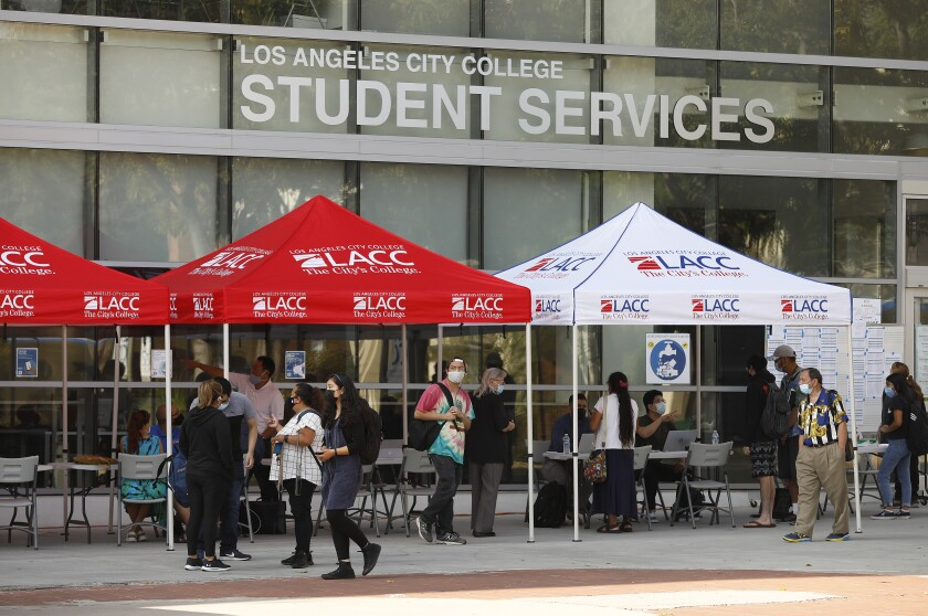 Students gather under tents at L.A. City College.