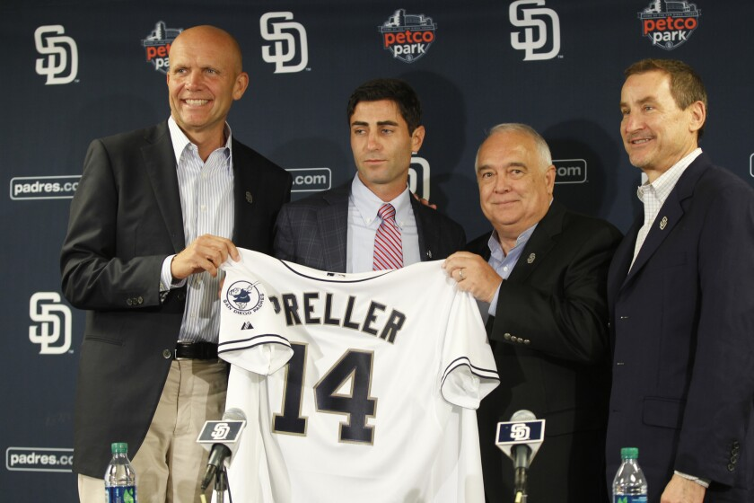 At a Padres new conference in Aug. 2014, from left are CEO Mike Dee, GM A.J. Preller, Chairman Ron Fowler, and lead investor Peter Seidler. Preller was announced as the replacement to Josh Byrnes.