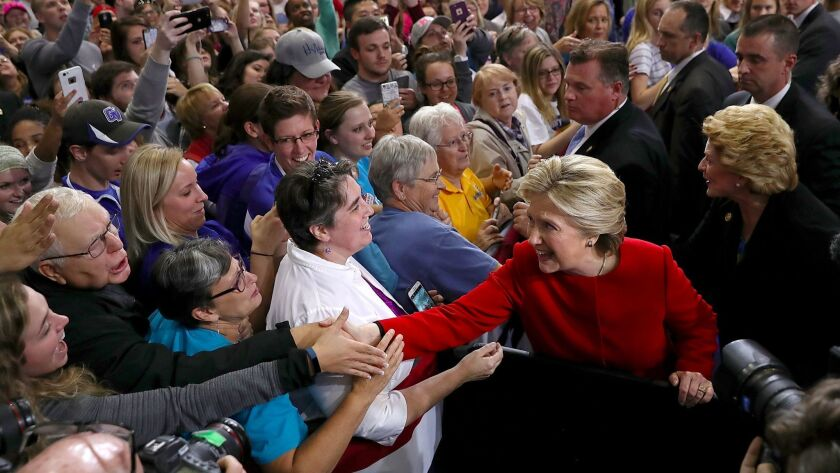 Democratic presidential candidate Hillary Clinton greets supporters. A Democrat-affiliated group called the  Indiana Voter Registration Project is being investigated by state police, who say they have found evidence of fraud but have not provided details.