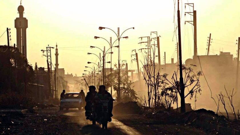 A view of the southern Syrian city of Dara in 2013. An opposition activist in the city reported an uneasy calm hours into a truce on July 9, 2017.