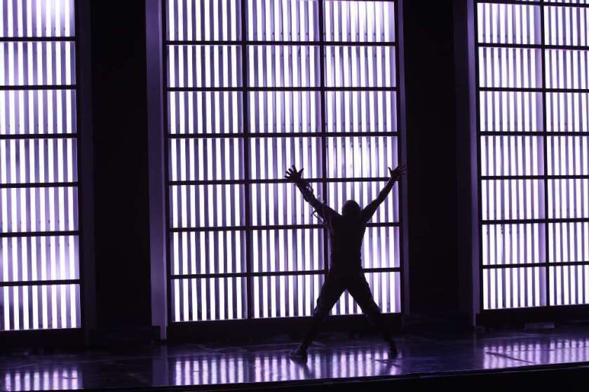 """Tenor Hal Cazalet in a scene from Tod Machover's """"Death and the Powers."""""""