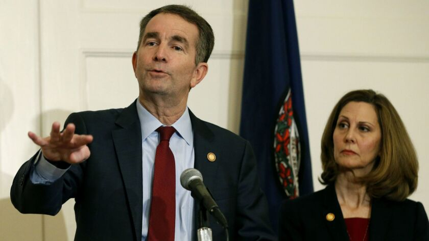 Virginia Gov. Ralph Northam and his wife, Pam. A law firm has completed its investigation into how a racist photo appeared on a yearbook page for Northam.