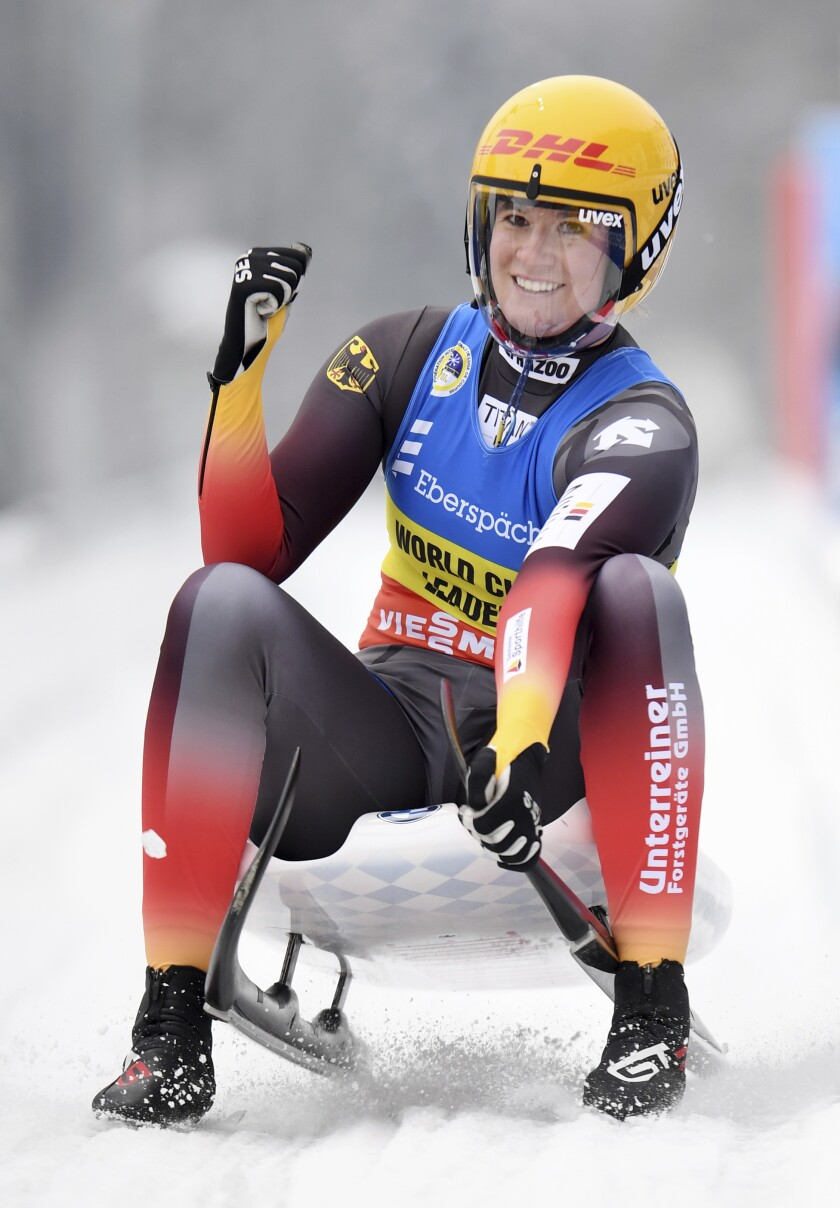 Second placed Natalie Geisenberger from Germany celebrates as she crosses the finish line for the women's single luge world cup race in Schoenau at the Koenigssee, Germany, Sunday, Jan. 3, 2021. (Tobias Hase/dpa via AP)