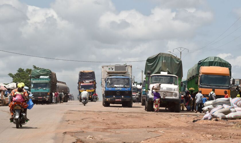 Trucks loaded with various goods make their way in Bouake, the second largest city in Ivory Coast. The cargo is on the way to Mali and Burkina Faso. African nations are wary of the consequences of Britain leaving the EU.